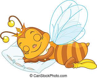 An adorable bee sleeping on a pillow