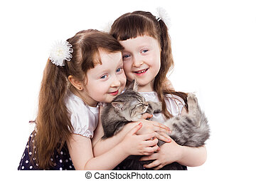 smiling girl twins with a cat
