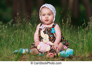 smiling little girl with a toy in hands