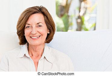 Smiling senior at home