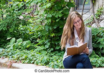Beautiful girl writing in her journal