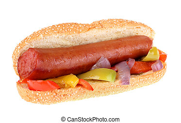 Smoked sausage on a sesame seed bun with bell peppers and onions isolated on white