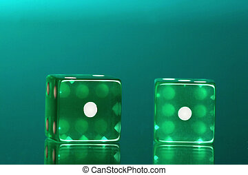 Dice with the ones showing green on green