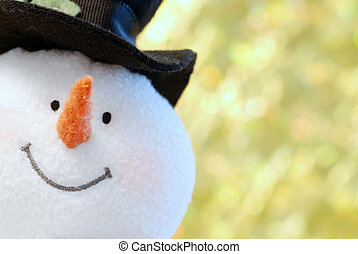 Snowman face close up with gold background