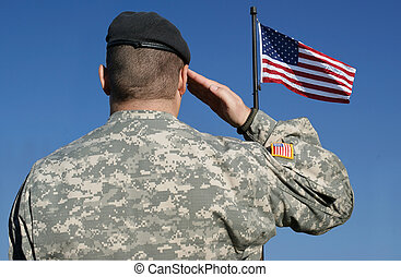 Image of an american soldier saluting the flag of the United States of America.