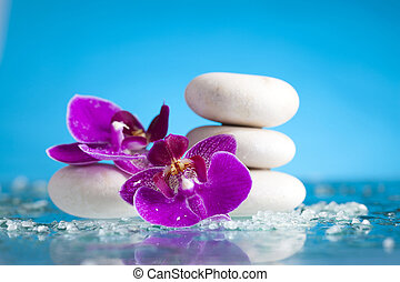 Spa still life with pink orchid and white zen stone in a serenit