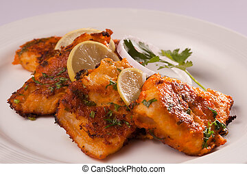 Spicy Fish Tikka is made from fish marinated in spicy masala and deep fried