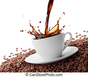 cup of coffee with splash surrounded by coffee beans