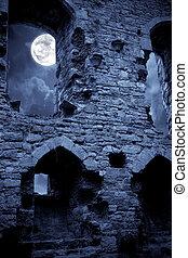A very spooky Halloween castle in the moonlight