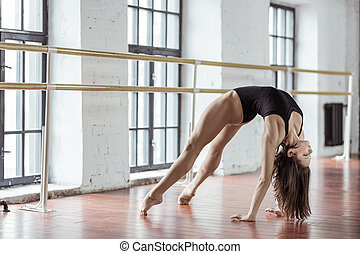 Sports young girl in the studio