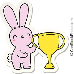 sticker of a cute cartoon rabbit with sports trophy cup