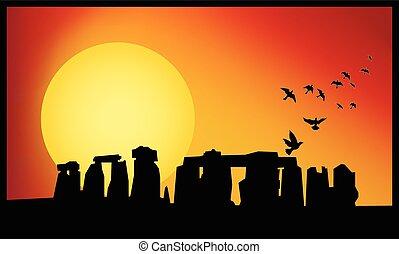 Stonehenge panorama. Stonehenge at sunset background. Rise birds from Stonehenge.