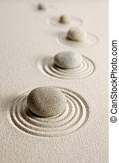 Stones on sand background
