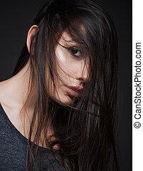 Studio closeup portrait of beautiful young girl
