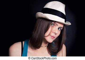 young blue-eyed girl in white hat