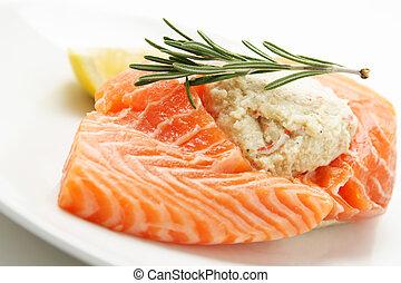 A piece of stuffed salmon on a plate