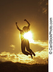 Silhouette of a woman expressing her success