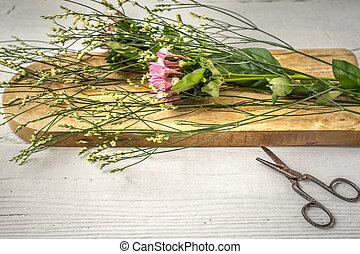 Summer flower on the wooden board