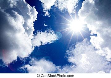 sun and clouds in blue sky
