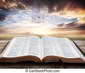 Open Bible with beautiful sunset
