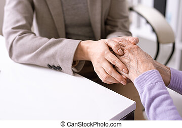 Supporting elderly woman