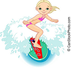 Surfer girl getting some height of a wave