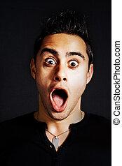 Surprise concept - portrait of amazed funny man