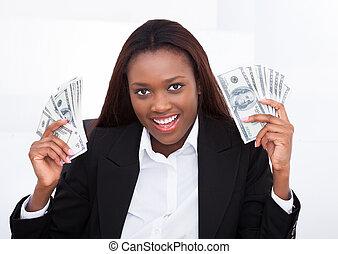 Surprised Businesswoman Holding Money Fan