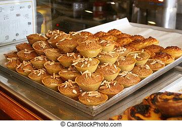 tarts and cupcakes at a bakery