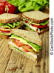 Tasty sandwiches with ham, cheese and fresh vegetables