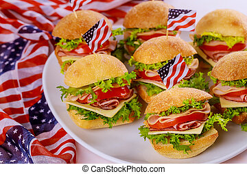 Tasty sandwiches with ham, tomato, cheese and lettuce for american holiday.