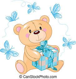 Cute Teddy Bear sitting with blue gift box