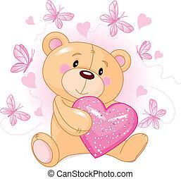 Cute Teddy Bear sitting with pink love heart