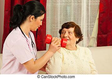 Therapist helping senior home
