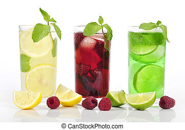 Three refreshing drinks in glasess with mint and ice isolated