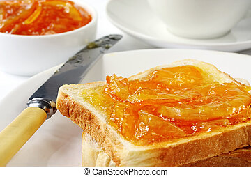 Toast with home-made orange marmalade, served with a cup of tea.