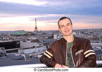Portrait of a man on background of Paris view