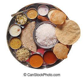 Traditional indian lunch food and meals with rice, phulka, puri, curries and sweets isolated on white