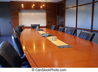 Meeting room with chairs and a white board.