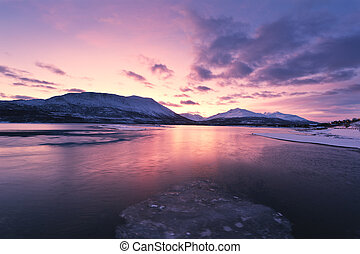 Twilight above a ford in Norway with beautifully colors, above the arctic circle