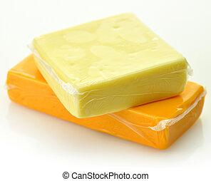 two blocks of cheddar cheese