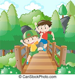 Two boys crossing the wooden bridge