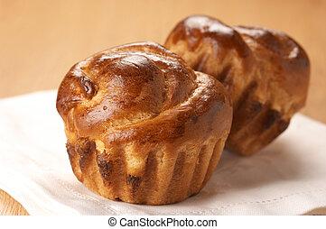 Two sweet buns on white linen napkin.