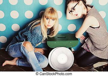 Two young girls with vinyl records