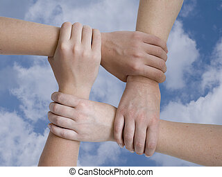 united hands over sky background