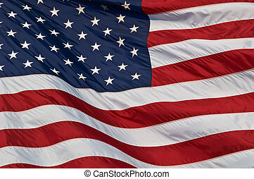 Image of the american flag flying in the wind.