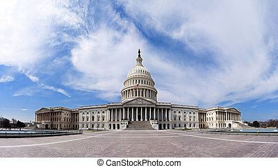 Wide angle panorama of the US United States Capitol building for Democrat Republican Government Senate and House congress parties under a summer blue sky with white clouds.