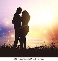 valentines couple in grassy sunset landscape
