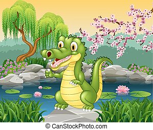 Cute crocodile posing on the rock