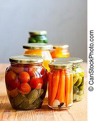 Vegetable preserves on wooden table